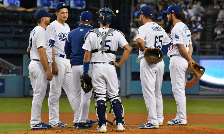 Dodgers clinch home field through NL playoffs = The Los Angeles Dodgers clinched home-field advantage throughout the National League playoffs with their 9-2 victory over the San Diego Padres on Tuesday night. Not only have.....