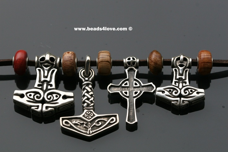 Silvers from left to right, Thor's Fertility Hammer Big, Thor's History Hammer, Pagan Kors, Thor's fertility Hammer small. In between the Tree Wood studio beads.