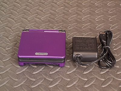 Nintendo Game Boy Advance SP Purple and Black Handheld System AGS001 - http://video-games.goshoppins.com/video-game-consoles/nintendo-game-boy-advance-sp-purple-and-black-handheld-system-ags001/