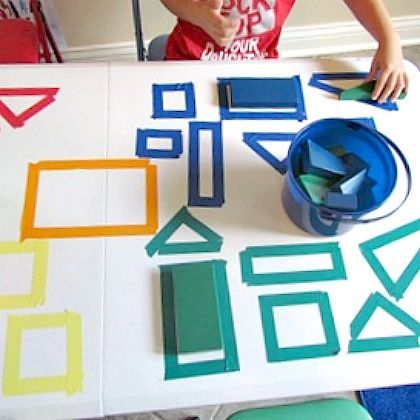 Tape Shape Sort. Outline shapes with tape. Kids place correct foam block on top of outline. Morning activity