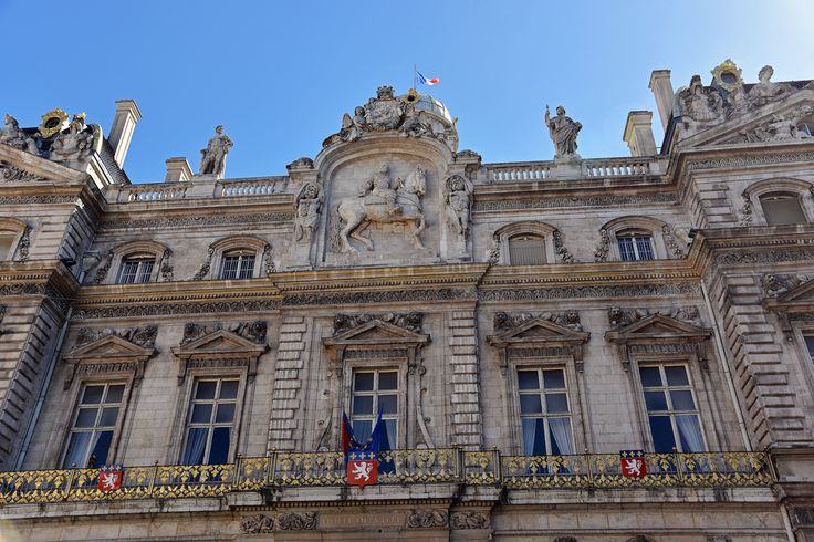 The Hôtel de Ville de Lyon [City Hall] is one of the largest historic buildings in the city, located between the Place des Terreaux and the Place de la Comédie, in front of the Opera Nouvel. It was built between 1645 and 1651 by Simon Maupin.  Following a fire in 1674, the building was restored and modified, including its facade, following a design by Jules Hardouin-Mansart and his pupil Robert de Cotte.  In 1792, during the French Revolution, the bas-relief of Louis XIV on horseback, in the…