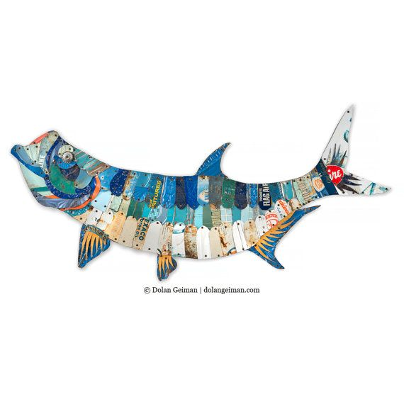 An artistic twist on the classic mounted fish, this salt water trophy fish -- the tarpon -- is constructed from hand-cut industrial metal with wood