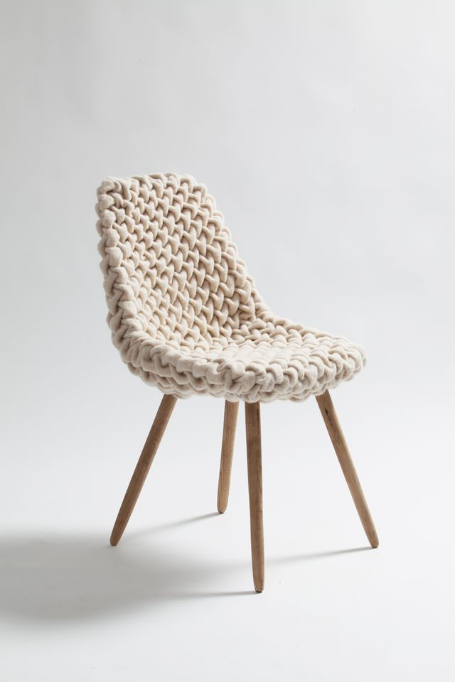 .- this! is there potential to do this myself? An old ugly chair and an old thick chunky knit sweater cut and resewn into a slip cover? :D hoho!