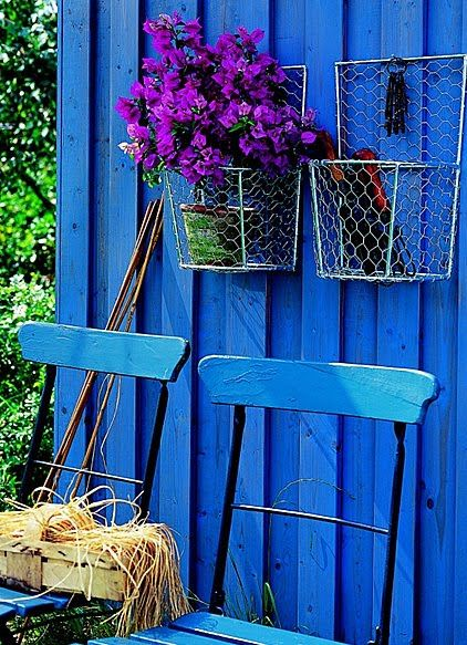 Blue wall. i would love to paint my backyard fence this color. it's fantastic. who could be sad w/this color surrounding them?
