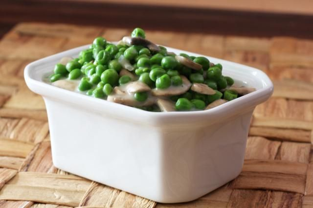 These light creamed peas are made with an easy and light white sauce, onions, and sauteed mushrooms. An easy and elegant recipe for peas.