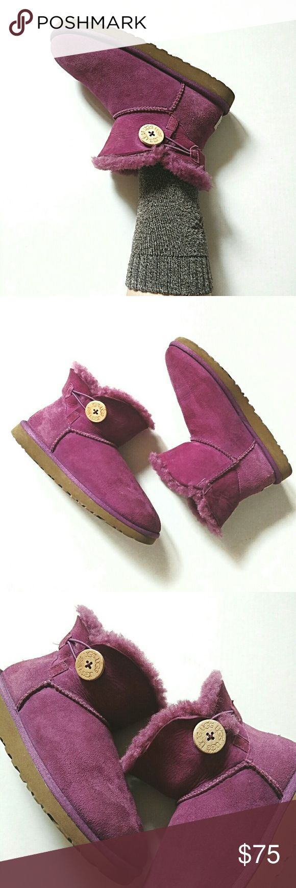 UGG Mini Bailey Button Purple Boots Ankle Booties Adorable!  Unique purple / pink color.  Size 6.  No salt marks or water stains. They are overall in nice and clean condition. Plenty of tread left on the soles and life left in them! UGG Shoes Ankle Boots & Booties