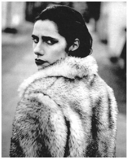 PJ Harvey. From dressing in skimpy clothes and heavy makeup to wearing mens suits and then on to Miss Havisham style wedding gowns with birds on her head, PJ Harvey always carries herself in a most wonderful manner and all her different looks show how she can be sexy in many different ways.