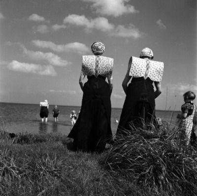 Thought you might like this for your blog :-)  Women in traditional Spakenburg wear at the IJsselmeer (the Netherlands).  Picture taken by Dutch photographer Kees Scherer.  Source picture: [x] (Gemeente Amsterdam Stadsarchief, de Beeldbank)  There are...