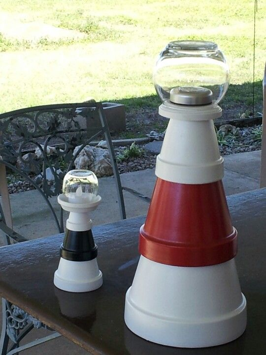 Lighthouses!! Terra cotta pots. This is great way to honor family heritage as last lighthouse keeper