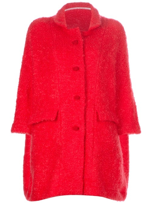 Red wool blend coat from Daniela Gregis featuring a high neck, a front button closure, side flap pockets, an oversized fit, a textured finish and wide three quarter length sleeves.