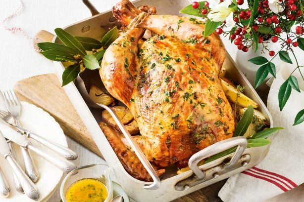 Roast lemon and mixed herb turkey - A turkey roasted to golden perfection with the fragrant flavours of lemon and thyme.