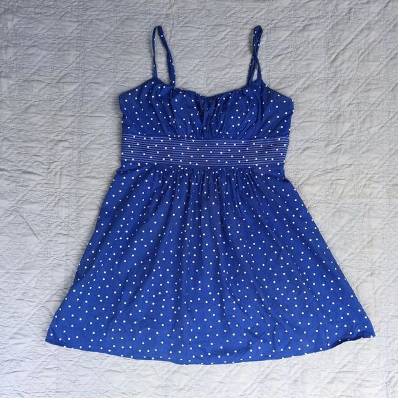 Ruched A-line Polka Dot Sundress This cute sundress has a ruched bust and a firm lined waistband. While there is no stretch to the material, the back zipper closure offers easy removal. Straps are non-adjustable. ✨100% polyester; Machine washable; 40in bust, 36in waist, 34in long✨ B. Smart Dresses Mini
