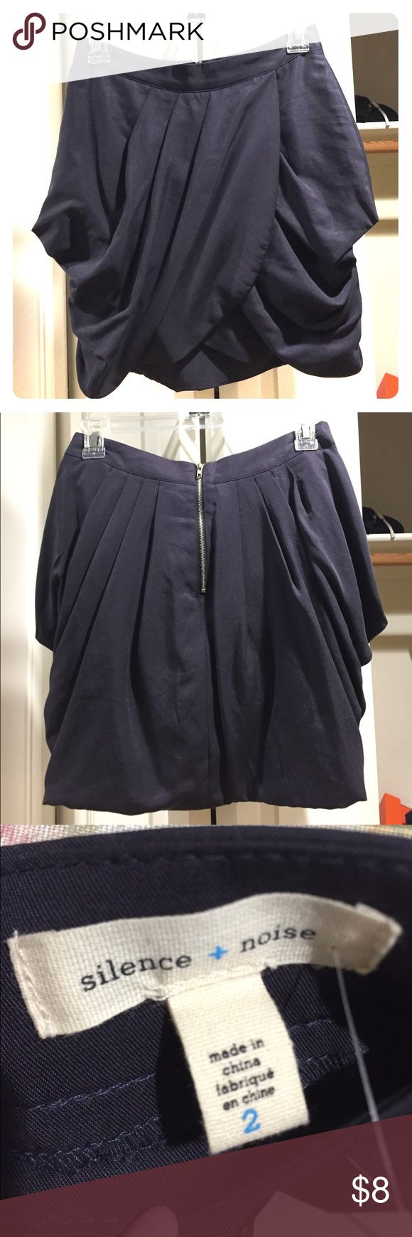 Urban Outfitters navy blue tulip skirt Size 2. NWT. Never worn. Shell: 100% tencel; lining: 100% polyester. I'm 5 feet tall, and the skirt hits about two inches from the top of my knees. Urban Outfitters Skirts