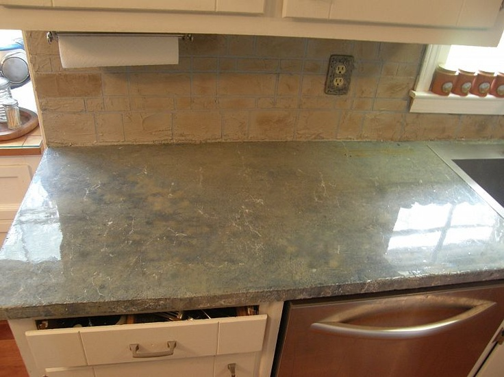Concrete Overlay Replicating Rare Blue Marble Countertop And Sandstone  Brick Backsplash  Very