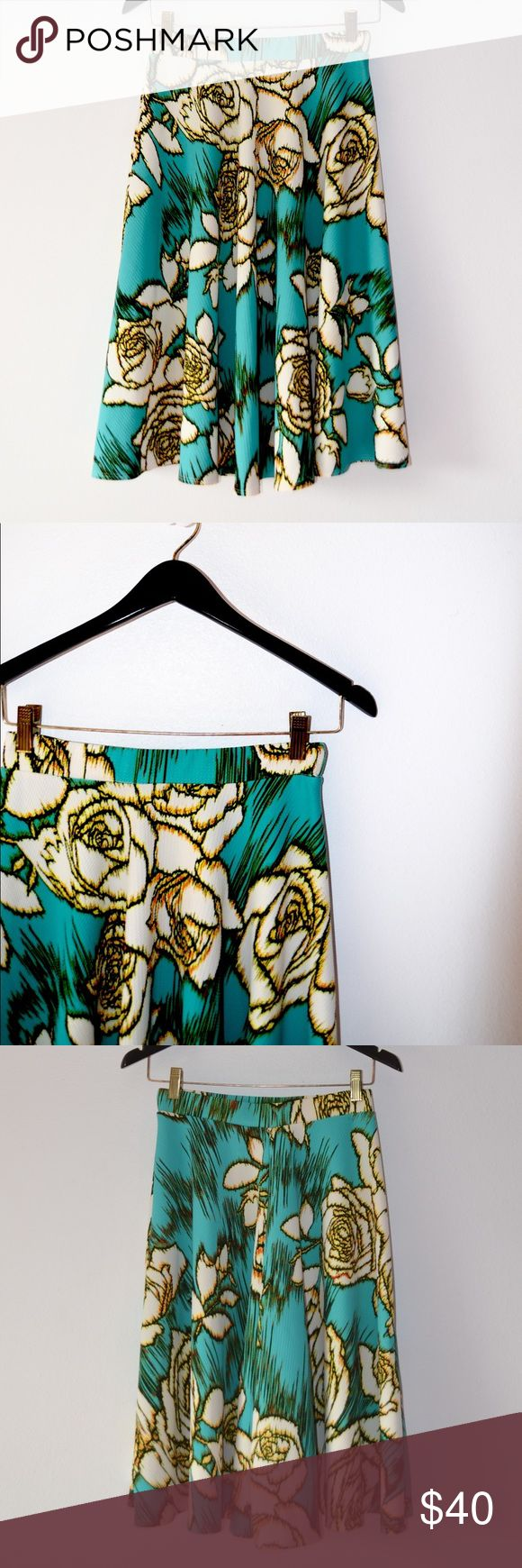 ••floral 50s style midi flare skirt•• Beautiful teal with white and yellow flowers • drops to the knees • skater-style flare • super cute and perfect • stretchy Skirts Midi