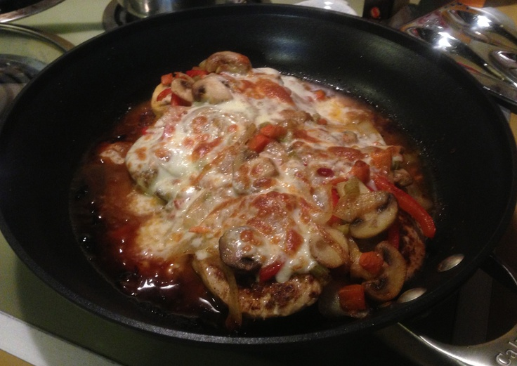 Pechuga Gratinada -- chicken breasts sautéd in olive oil and butter. I then topped it with onions, red peppers, and minced carrots/celery (also sautéd in olive oil), and crowned it with mozzarella cheese and browned under the broiler.