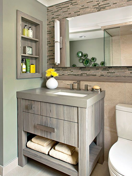 A sleek, storage-rich vanity sets the tone in the reorganized bathroom.