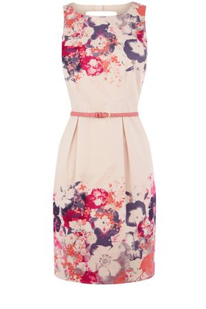 This pretty tulip skirt dress is sleeveless in style and has cut out detailing to the back. With a placement print to the hem and the shoulders, this is the perfect dress for any occasion.