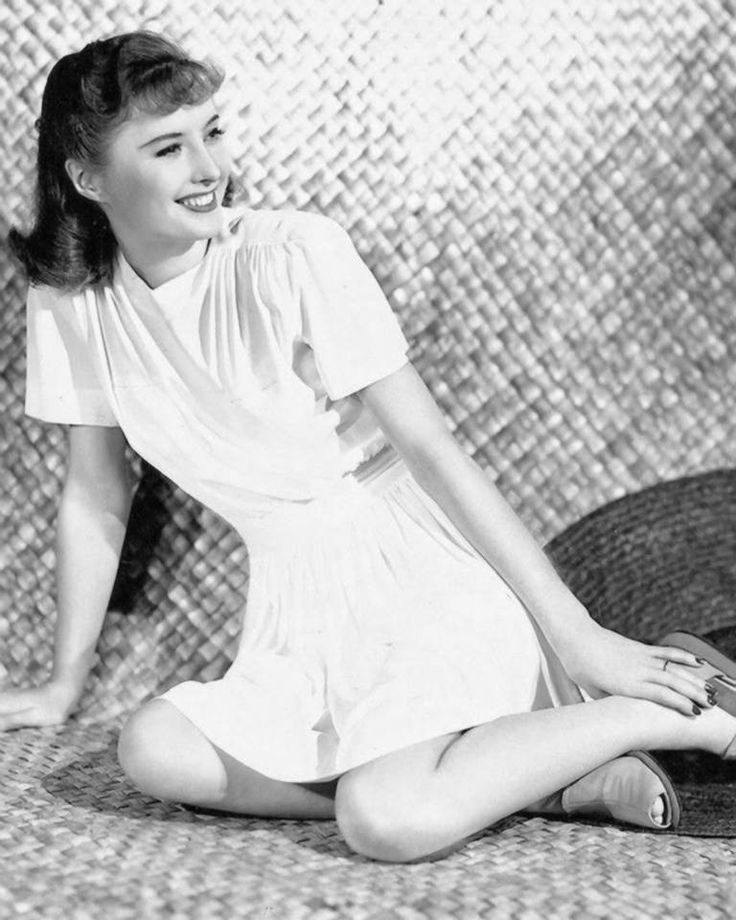 Barbara is staying summer fresh wearing a sunsuit and sandals in this 1941 promotional shot.