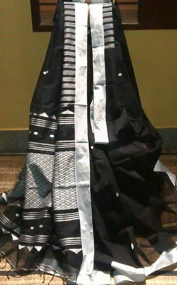 A black and silver Bengal taant cotton saree