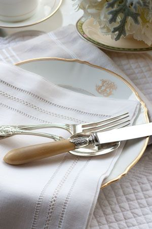 Classic white china with gold monogram