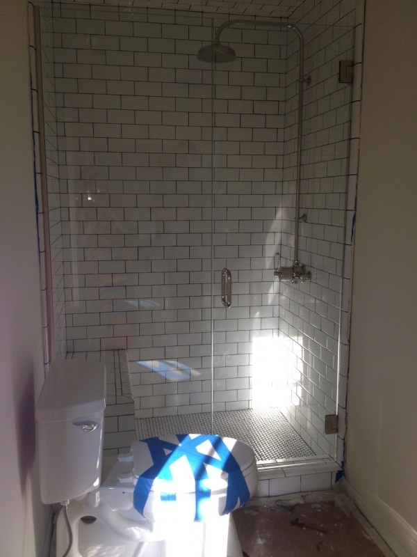 redo a small bathroom%0A Great small shower remodel  subway tile  dark grout  built in bench