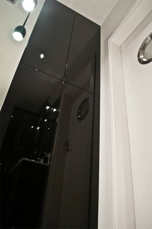 black glossy closett in bathroom