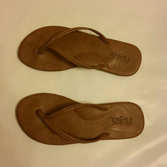 Flojos brown flip flops Only worn once, these flip flops are very cute. Leather feel, but we're too flat for my high arches. flojos Shoes Sandals