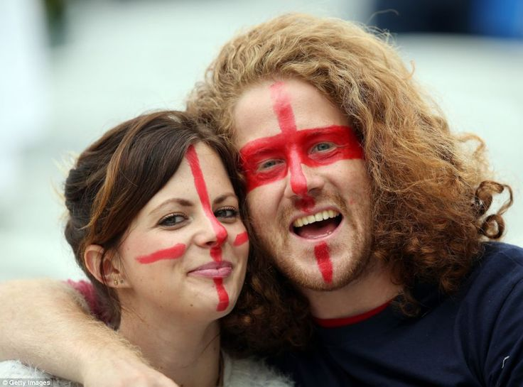 Lion-hearts: Two fans soak up the atmosphere as the match gets under way in Sao Paulo...