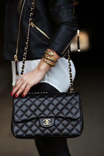 Black leather moto jacket w/ golden hardware + snake cuff + Chanel shoulder bag