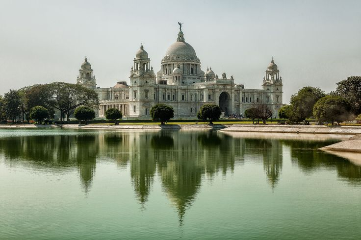 Victoria Monument and its reflection in the placid waters of a lake, Kolkata, India