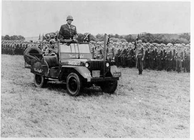 Gen. George S. Patton inspects units of the 301st Combat Team at Strakonice, Czechosolvakia, 1945.