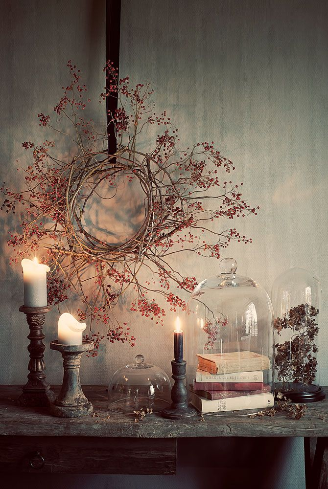 gah! everything about this is gorgeous... from the natural dried berry wreath to the cloches to the old books to the candlesticks... sigh.