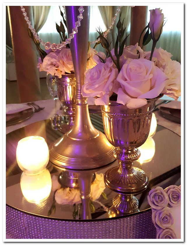 Classic Chic Wedding Decor and Flowers with a combination of silver bling and elegant white roses at wedding venue Casablanca Manor in Pretoria East www.casablancamanor.co.za