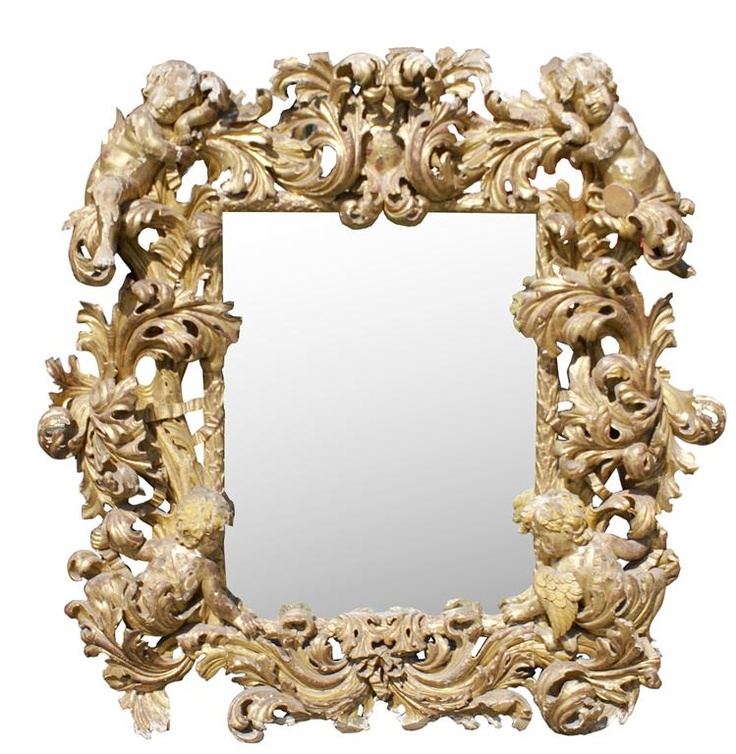 Gilt wood rococo mirror with babies and acanthus leaves intertwined to form frame, 18th century.  4.8' H x 4.8' W
