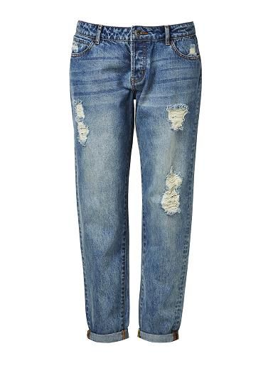 100% Cotton Boyfriend Jean. Comfortable Boyfriend style features a true denim fabrication texture with ripped affect at front body. Available in Mid Blue.