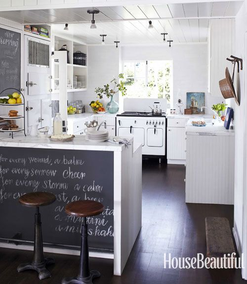 love this kitchen… brightness of white and warmth of dark colours. fruits and flowers are always great feng shui, too! notice the high gloss panelled ceiling, brings so much more light… love it love it love it!