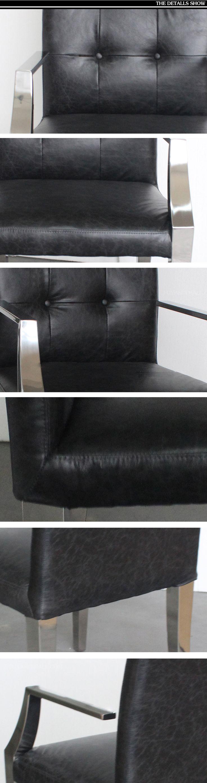 Черная кожаная обивка у кресла из металла с хромированными ручками