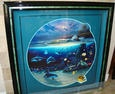 We have this one : )  Love Wyland art...