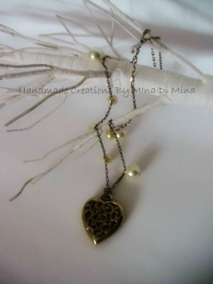 ....μεταλλική καρδιά σε μπρονζέ χρώμα και γυάλινες πέρλες....! | myartshop