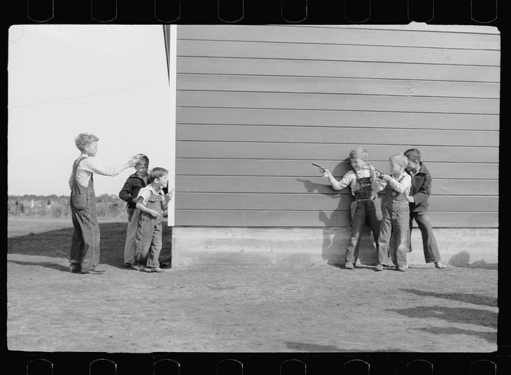 Children Playing Cowboys and Indians by Arthur Rothstein