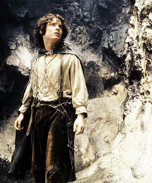"""""""Stand! stand!"""" he cried desperately. """"Running is no use.""""...Then Frodo's heart flamed with him, and without thinking what he did, whether it was folly or despair or courage, he took the Phial in his left hand, and with his right hand drew his sword. Sting flashed out, and the sharp elven-blade sparkled in the silver light, but at its edges a blue fire flickered. Then holding the star aloft and the bright sword advanced, Frodo, hobbit of the Shire, walked steadily down to meet the eyes."""