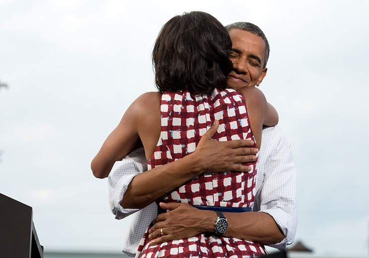 August 15, 2012: 'The President hugs the First Lady after she had introduced him at a campaign event in Davenport, Iowa. The campaign tweeted a similar photo from the campaign photographer on election night and a lot of people thought it was taken on election day.'