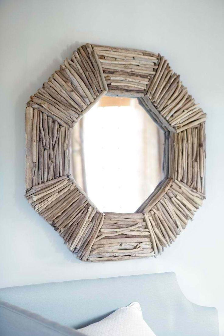 Espejo con marco de ramas