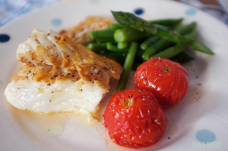 Fast day pan fried cod loin with roasted vine tomatoes and greens.