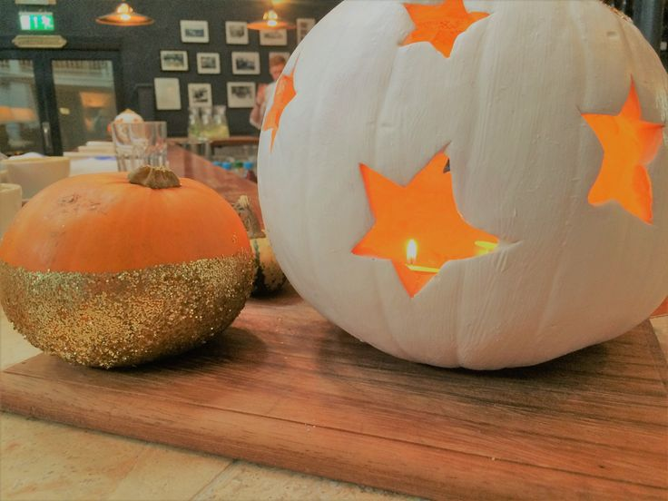 Ruth and Sarah butchered this pumpkin! but the  orange light contrasts lovely with the white especially when it gets dark..and the gold glitter I love on the little one!