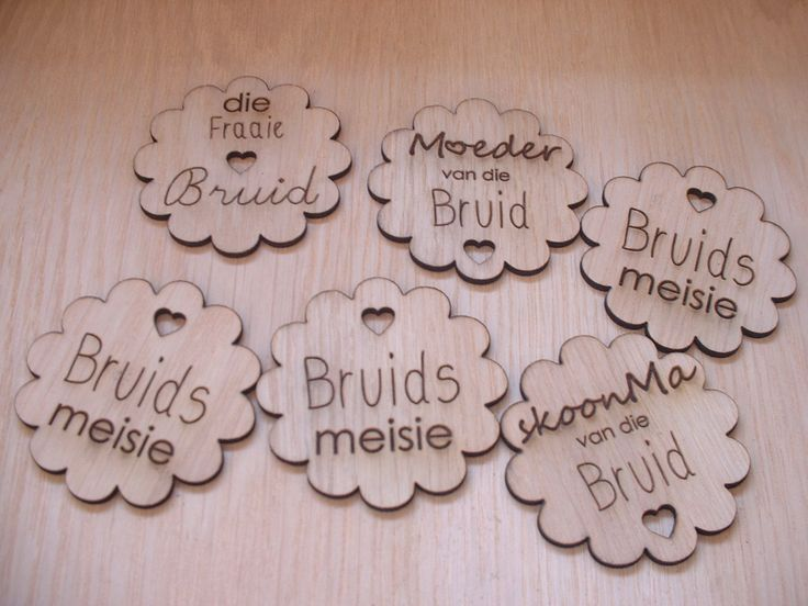 Laser cut and engraved brooches/ badges