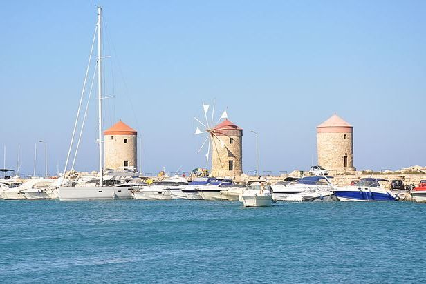 3 Of the Windmills standing in Mandraki Harbor. But how many were there originally and what was their function?  https://theislandofrhodes.com/the-city-of-rhodes-in-greece