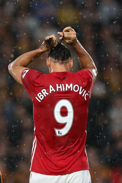 Zlatan Ibrahimovic of Manchester United ties up his hair during the Premier…