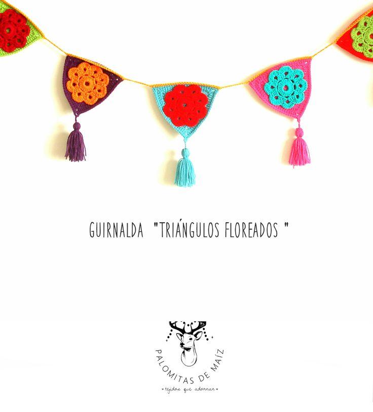 Guirnalda crochet Triángulos floreados en https://ofeliafeliz.com.ar/espacio/palomitasdemaiz